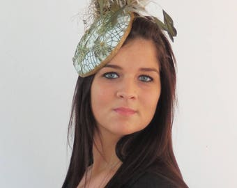 Dutch design multi color lace hat ranging from soft green to goldish with lots off ton sur ton feathers on aliceband