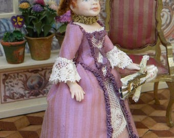 Porcelain dollhouse doll, girl dressed in Rococo, Georgian, 18th century style