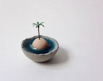 Miniature island in a concrete bowl, teeny tiny, tiny beach, miniature landscape, tiny decor, concrete