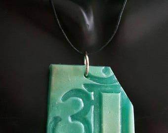 Om - pendant, spiritual mantra, handmade from polymer clay