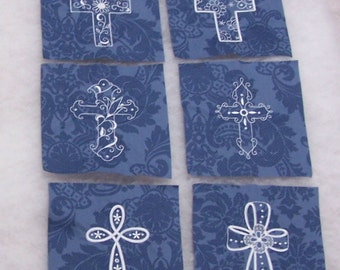Second Set of Embroidered Crosses on Blue Floral Fabric