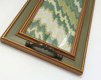 Upcycled vintage rectangular gold and green frame tray with vintage brass handles and vintage-inspired green upholstery fabric