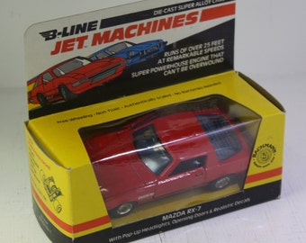 Vintage NOS Bachmann  Die Cast B Line Jet Machine  Clock spring gearbox scale model Mazda RX-7 with pop up headlight and opening doors