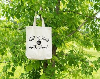 Ain't no hood like motherhood market bag. Customize text color. Canvas tote bag.