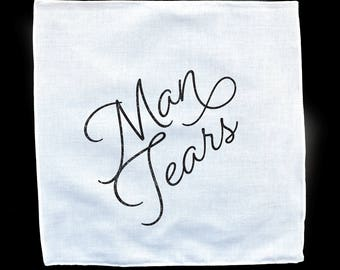 Man Tears White Handkerchief