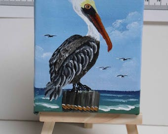 "Beautiful Pelican On a Piling in Shem Creek Near Charleston, SC.  Hand Painted 3"" X 4"" on 6"" Mini Easel"