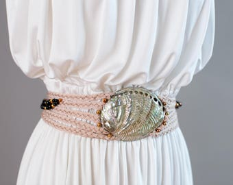 Greek goddess inspired 1980s pink rope, fringe, and beaded mermaid belt with large shell statement piece