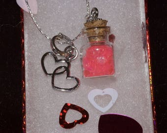 Tiny hearts or stars in glass vial pendant necklace