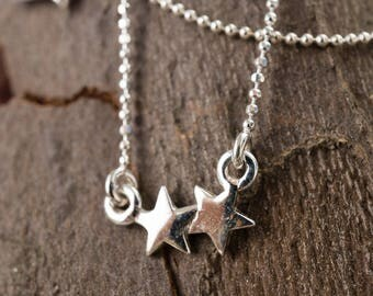 Ball chain necklace with two sparkling stars
