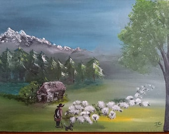 A shepherd and his flock of sheep in the mountain