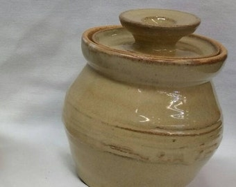 Lidded stoneware pot hand thrown on the stoneridges of the Ozarks'.