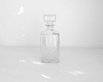 Vintage whiskey decanter style 80's glass with embossing.