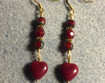 Blood red Czech glass heart bead dangle earrings adorned with dark red Czech glass beads.