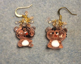 Pink and white glow in the dark tiger charm earrings adorned with small dangling pink Czech glass beads.