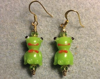 Opaque olive green lampwork frog bead earrings adorned with olive green Chinese crystal beads.