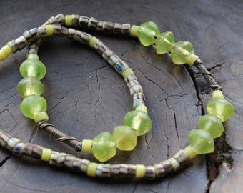 Bohemian beaded necklace, artisan piece using old AFrican trade beads.  A translucent petrol green glass with great patina Unisex design.