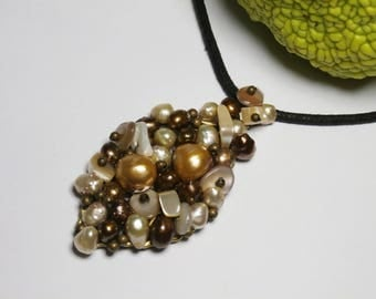 covered in pearls and mother of Pearl leaf pendant necklace