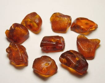 L64/9 amber beads raw cognac color