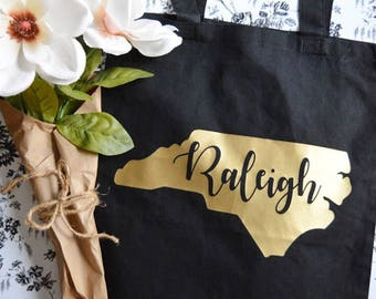 Raleigh, NC in gold - tote bag