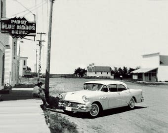 Buick in Small Western Town Black and White photo