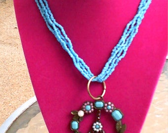 Peace necklace with baby blue seabeads