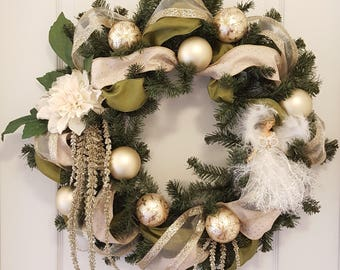 Victorian style Christmas wreath in gold, cream, white and green