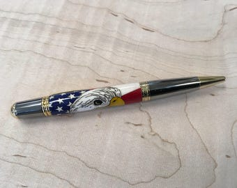Handmade bald eagle and flag twist pen with wood inlays by Specialty Turned Designs