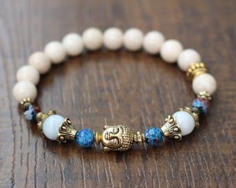 White fossil stone bracelet, golden Buddha charm