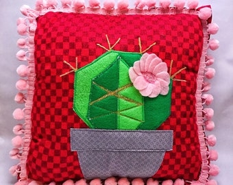 Cactus decorative cushion with fancy pink poms in bloom