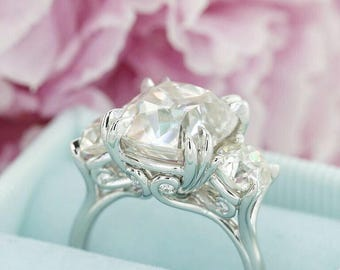 "Our Stunning ""Scroll"" Three Stone"
