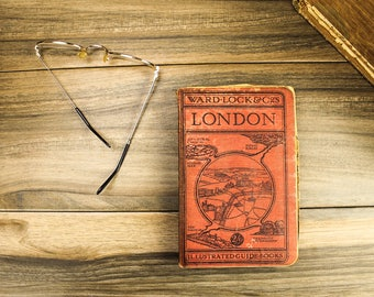 1934, London. Vintage city guide. Complete with foldout maps and illustrations. Incredible detail. Ideal for gift or display.