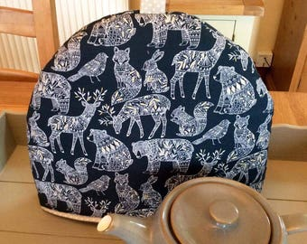 Tea cozy, tea cosy in navy blue with a gorgeous print of wildlife including Rabbit, Deer, Fox and Bear. Fits a four to six cup teapot.