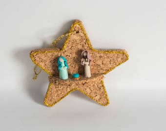 Decorated and colored stars in Cork with Nativity, to hang