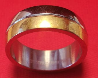 ring with stripes of gold and steel