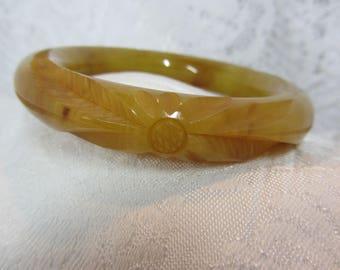 Bakelite Bangle - Cloudy Honey Colored Carved Flower Design
