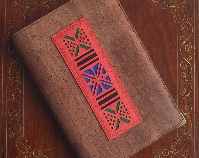 Mid-brown cork leather A5 notebook enhanced with an appliqué of an African pattern laser cut in red cork backed with coloured leathers