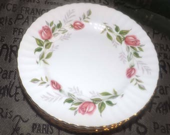 Vintage (c.1960s) Paragon Fragrance pattern bread-and-butter or tea plate. Pink rose blooms, greenery and a scalloped, gold edge.