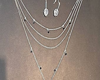 Multiple necklace and earrings