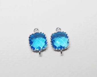 G0001C/Capri Blue/Rhodium plated over brass/Tooth Framed square faceted glass connector/9mm x 13.4mm/2pcs