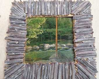 Small wooden wall frame design and natural wood branch