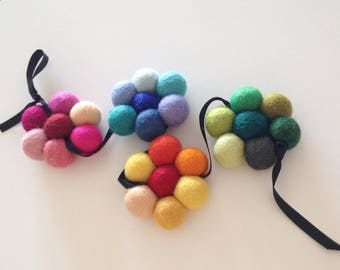 Flower garland to decorate your interior with multi-color felted wool balls