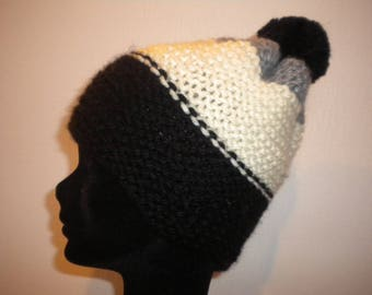 Hat with a handmade woolen tassel of three color