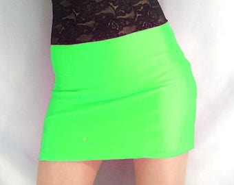 High waisted neon green shiny spandex mini skirt with black lace top