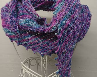 Hand knitted hitchhiker shawl in hand dyed wool.