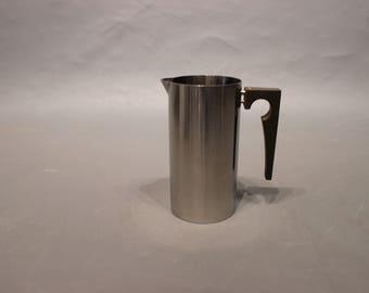 Milk jug  designed by Arne Jacobsen for Stelton.