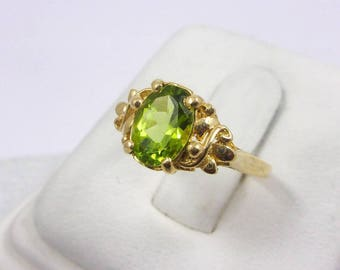Solid 14K Yellow Gold 1.2 Carat Oval Cut Peridot Ladies Ring Size 6.5, 2.2 grams