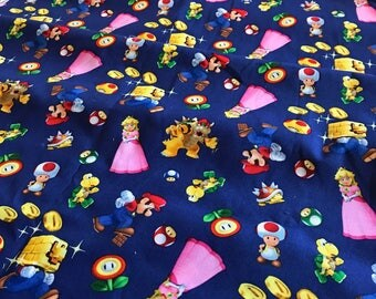 Nintendo Super Mario Brothers Packed Woven 100% Cotton Fabric - 1 yard