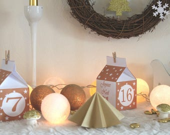Christmas: as 24 beige boxes starry print and mount advent calendar