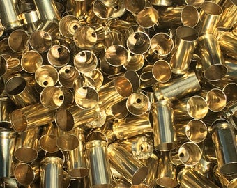 Processed 40 SW Once Fired Brass Casings. These are perfect for Reloading or Jewelry making! *These do not have primers in them*