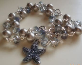 Double stranded bracelet with Swarovski pearls, Rondelle beads and a pewter blue starfish charm